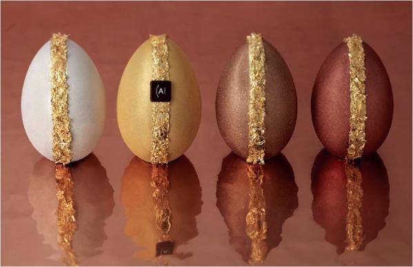 Quatre œufs aux couleurs de fête : Or, Argent, Cuivre et Bronze, qui découvrent sous une enveloppe scintillante des saveurs de chocolat noir grand cru du Brésil, chocolat au lait, lait et noisette.